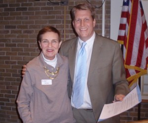 Pat Koko, outreach coordinator of the Oak Park Arms Adult Day Care with David Pope, Oak Park village president, after the Village of Oak Park proclaimed May as Older Americans Month and May 16 to 23 as Celebrating Seniors Week in Oak Park.